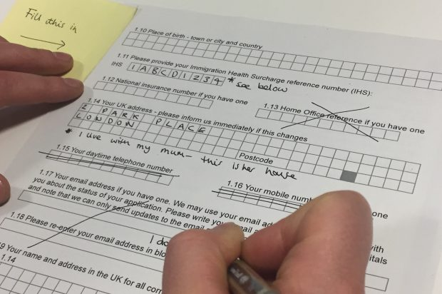 Picture of someone filling out a paper form