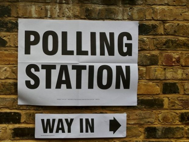 A sign giving directions to a polling station