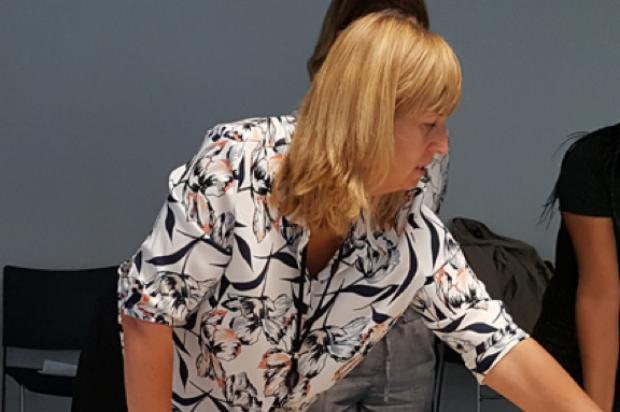 Jane Devine, Senior User Researcher in a meeting