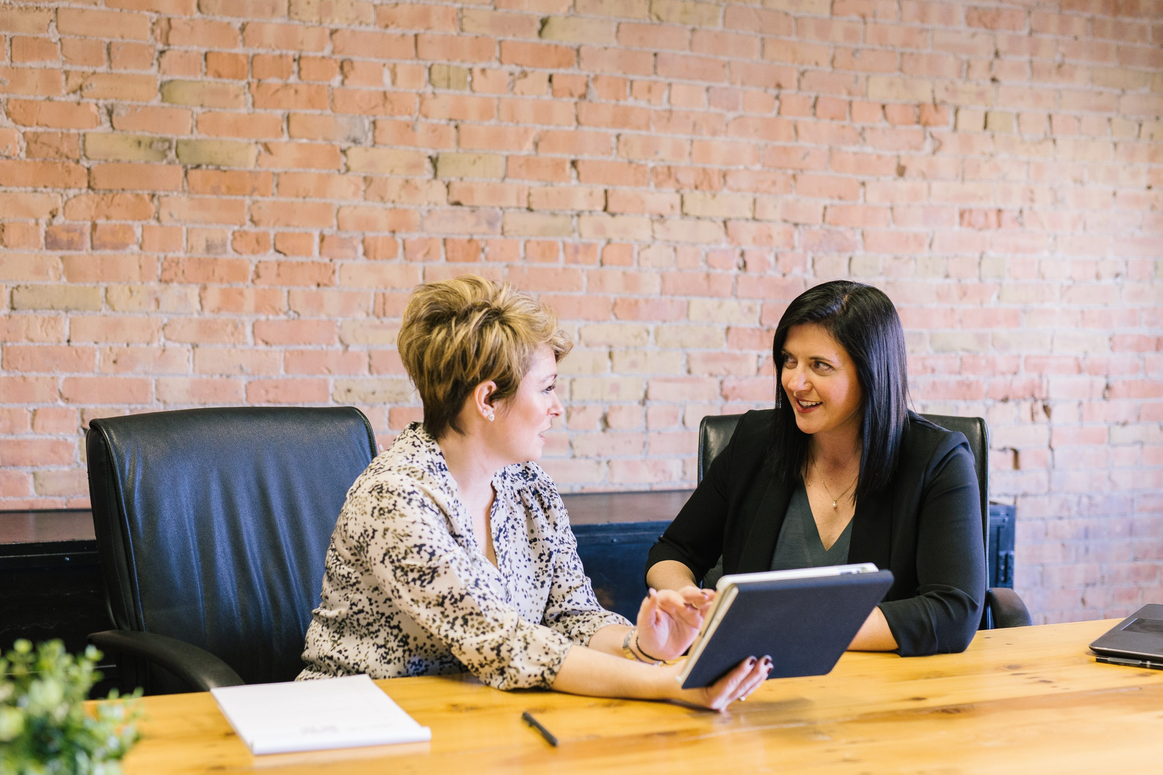 Image of two women sitting in an office in discussion